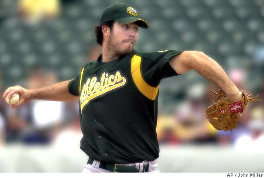 Oakland Athletics starter Dan Haren works the second inning against the Chicago White Sox in a spring training game at Tucson Electric Park in Tucson, Ariz., Monday, March 28, 2005. (AP Photo/John Miller) Photo: JOHN MILLER