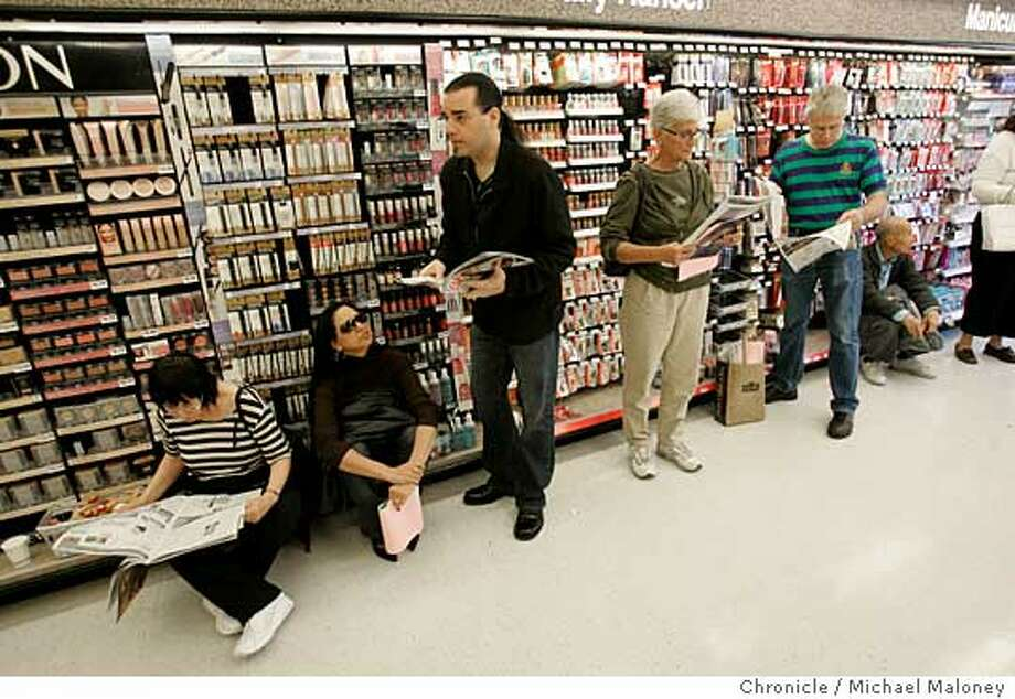 People line up for flu shots at a Walgreens in San Francisco. Despite the vaccine shortage and recommendations by health officials that middle-aged adults skip their shots voluntarily, many people not considered high risk showed up for shots. Chronicle photo by Michael Maloney