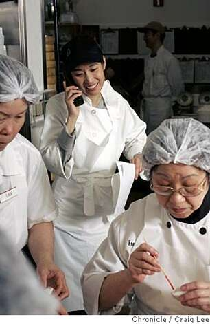 YANKSING30_311_cl.JPG  Photo of Vera Chan-Waller on the phone. Story on the Chan Family, who runs Yank Sing in Rincon Center, San Francisco's premiere dim sum destination. It was founded in 1958 by Alice Chan. Her son, Henry and his wife Judy, have run it since around 1980. Now their daughter, Vera and her husband, Nathan, are learning the ropes, stepping up to keep the family business thriving. Event on 3/17/05 in San Francisco. Craig Lee / The Chronicle MANDATORY CREDIT FOR PHOTOG AND SF CHRONICLE/ -MAGS OUT Photo: Craig Lee
