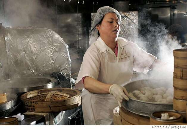 YANKSING30_607_cl.JPG  Photo of Qing Peng with a steamer with freshly cooked dim sum. Story on the Chan Family, who runs Yank Sing in Rincon Center, San Francisco's premiere dim sum destination. It was founded in 1958 by Alice Chan. Her son, Henry and his wife Judy, have run it since around 1980. Now their daughter, Vera and her husband, Nathan, are learning the ropes, stepping up to keep the family business thriving. Event on 3/17/05 in San Francisco. Craig Lee / The Chronicle MANDATORY CREDIT FOR PHOTOG AND SF CHRONICLE/ -MAGS OUT Photo: Craig Lee