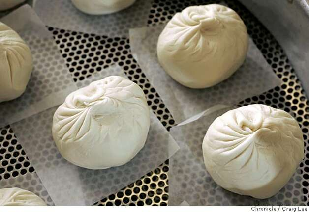 YANKSING30_624_cl.JPG  Photo of pork buns to be steamed. Story on the Chan Family, who runs Yank Sing in Rincon Center, San Francisco's premiere dim sum destination. It was founded in 1958 by Alice Chan. Her son, Henry and his wife Judy, have run it since around 1980. Now their daughter, Vera and her husband, Nathan, are learning the ropes, stepping up to keep the family business thriving. Event on 3/17/05 in San Francisco. Craig Lee / The Chronicle MANDATORY CREDIT FOR PHOTOG AND SF CHRONICLE/ -MAGS OUT Photo: Craig Lee
