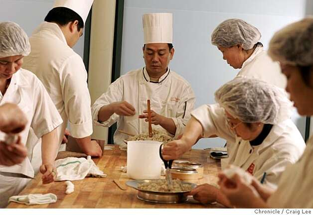 YANKSING30_083_cl.JPG  Photo of Executive chef, Yu Chuan Liu, at the head of the table, making some dim sum. Story on the Chan Family, who runs Yank Sing in Rincon Center, San Francisco's premiere dim sum destination. It was founded in 1958 by Alice Chan. Her son, Henry and his wife Judy, have run it since around 1980. Now their daughter, Vera and her husband, Nathan, are learning the ropes, stepping up to keep the family business thriving. Event on 3/17/05 in San Francisco. Craig Lee / The Chronicle MANDATORY CREDIT FOR PHOTOG AND SF CHRONICLE/ -MAGS OUT Photo: Craig Lee