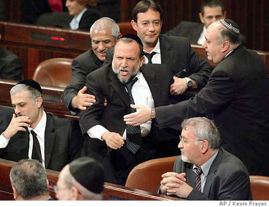 Israeli Knesset Member Itzhak Cohen from the right-wing Shas party, is removed by security following an outburst during the reading of the budget in the Knesset, Israel's Parliament, in Jerusalem, Tuesday,March 29, 2005.(AP Photo/Kevin Frayer) Photo: KEVIN FRAYER