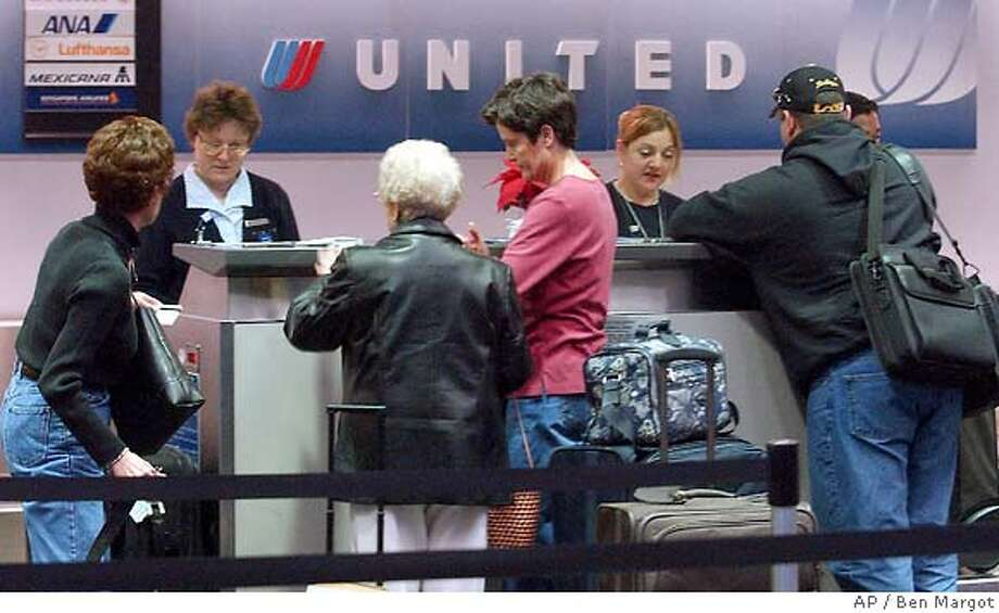United Airlines ticket agents assist passengers Monday, Dec. 9, 2002, at San Francisco International airport in San Francisco. UAL, the nation's No. 2 air carrier, filed for bankruptcy protection Monday. (AP Photo/Ben Margot) also ran 12/14/03 CAT Business#Business#Chronicle#10/07/2004#ALL#Advance##421801477 Photo: BEN MARGOT