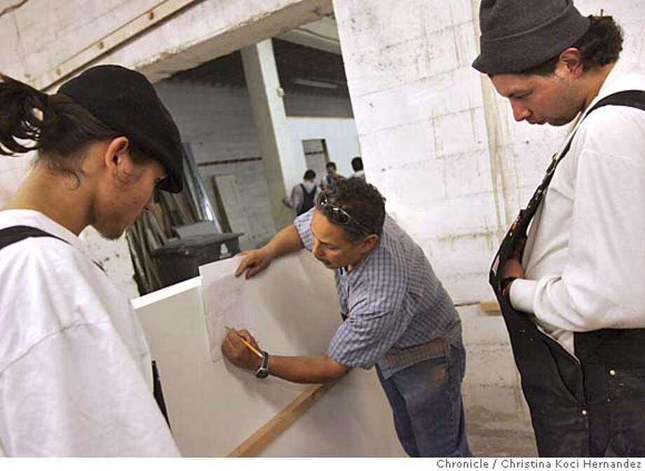 build28015_ckh.jpg  Carpentry instructor, (center) Gilbert De Anda, instructs students (far left) Andrew Kutches, (far right) Carlos Rojas, on how to build shelving for computers.  Description: Kids and staff at the Asian Neighborhood design headquarters in San Francisco. The organization takes at-risk young people and provides them with skills in construction work, and has helped some get full-time jobs in the field. A graduation ceremony for recent participants will be held March 29. one youth, Demass Bell, lived a tough life on the streets of Bayview Hunters Point, and was shot seven times. He's now found a job and is looking forward to making something of his life. .CHRISTINA KOCI HERNANDEZ/CHRONICLE Photo: CHRISTINA KOCI HERNANDEZ