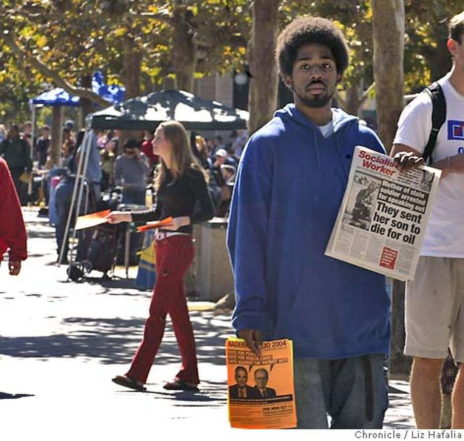 Philosphy student, Michael Watson, handing out flyers for Students for Nader and the International Socialist Organization announcing the Nader/Camejo 2004 campaign rally coming next Monday and showing the socialist paper at Sproul Plaza.  Shot on 10/6/04 in Berkeley. LIZ HAFALIA/The Chronicle Photo: Liz Hafalia