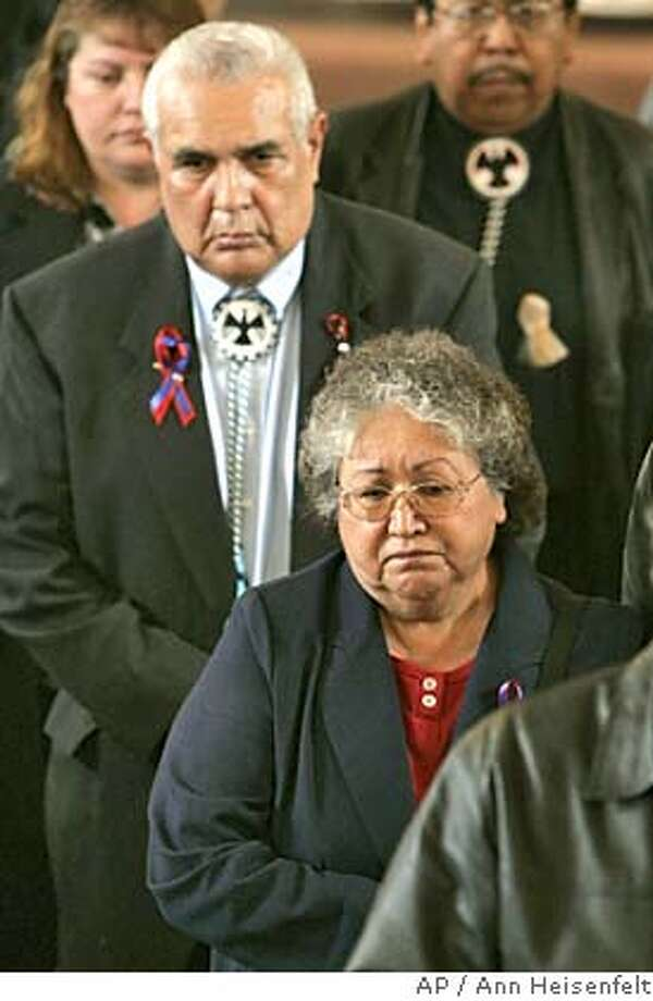 Barbara Brun, right front, and Francis Brun, left rear, parents of Red Lake High School security guard Derrick Brun, follow his casket out of St. Mary's Catholic Church in Red Lake, Minn., Monday, March 28, 2005. Brun was one of the seven people killed by Jeff Weise, a 16-year-old student at Red Lake High School, one week ago. Weise also shot his grandfather, his grandfather's companion and then himself. (AP Photo/Ann Heisenfelt) Photo: ANN HEISENFELT