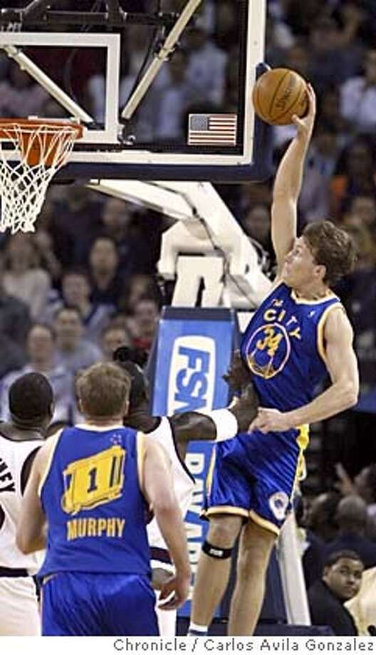 WARRIORS29_012_CAG.JPG  Warriors's Mike Dunleavy goes in for a dunk in the second quarter of play, but is fouled on the attempt. The Golden State Warriors played the New York Knicks at the Oakland Arena in Oakland, Ca., on Monday, March 28, 2005 Photo by Carlos Avila Gonzalez / The San Francisco Chronicle  Photo taken on 3/28/05 in Oakland, CA. MANDATORY CREDIT FOR PHOTOG AND SAN FRANCISCO CHRONICLE/ -MAGS OUT Photo: Carlos Avila Gonzalez