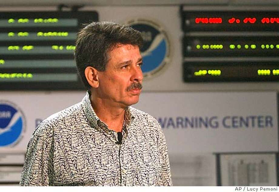 Dr. Charles McCreery, director of the Pacific Tsunami Warning answering questions in Ewa Beach, Hawaii, Monday, March 28, 2005. The center is monitoring the status of the 8.6 earthquake in Sumatra at the resulting small tsunami waves that hit the Maldive Islands, Cocoa Islands and Sri Lanka. (AP PHOTO/Lucy Pemoni) Photo: LUCY PEMONI