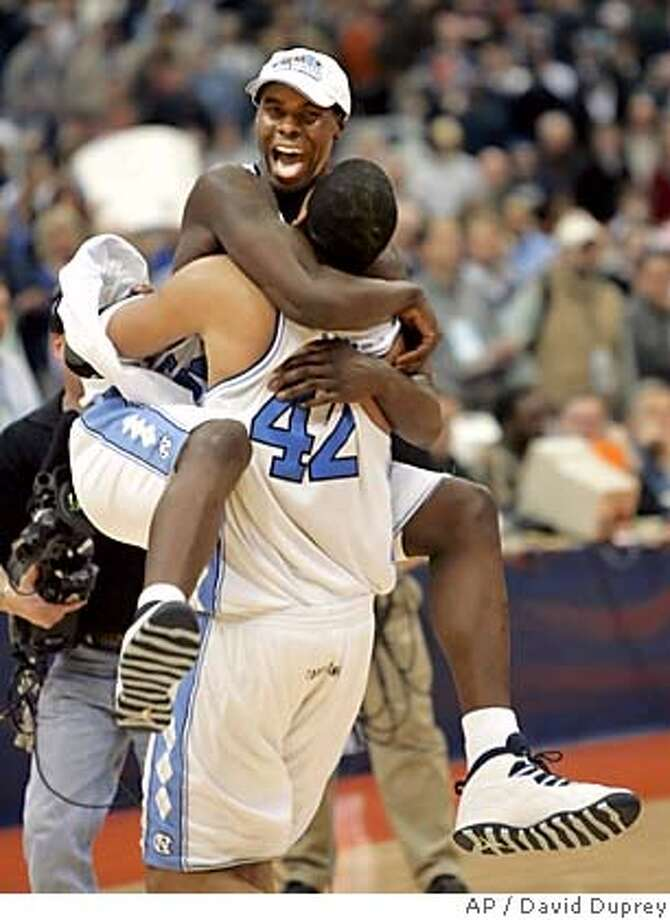 North Carolina's Marvin Williams leaps into the arms of teammate Sean May (42) after their 88-82 win over Wisconsin in the NCAA East Regional final Sunday, March 27, 2005, at the Carrier Dome in Syracuse, N.Y. (AP Photo/David Duprey) Photo: DAVID DUPREY