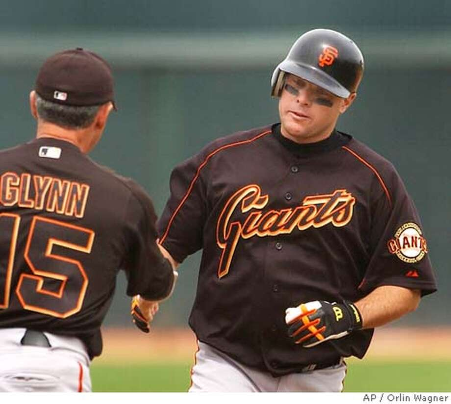 San Francisco Giants' J.T. Snow, right, is congratulated by third base coach Gene Glynn (15) following his solo home run in the first inning against the Texas Rangers at spring training in Surprise, Ariz., Monday, March 28, 2005. The home run came off starting pitcher Chris Young. (AP Photo/Orlin Wagner) Photo: ORLIN WAGNER