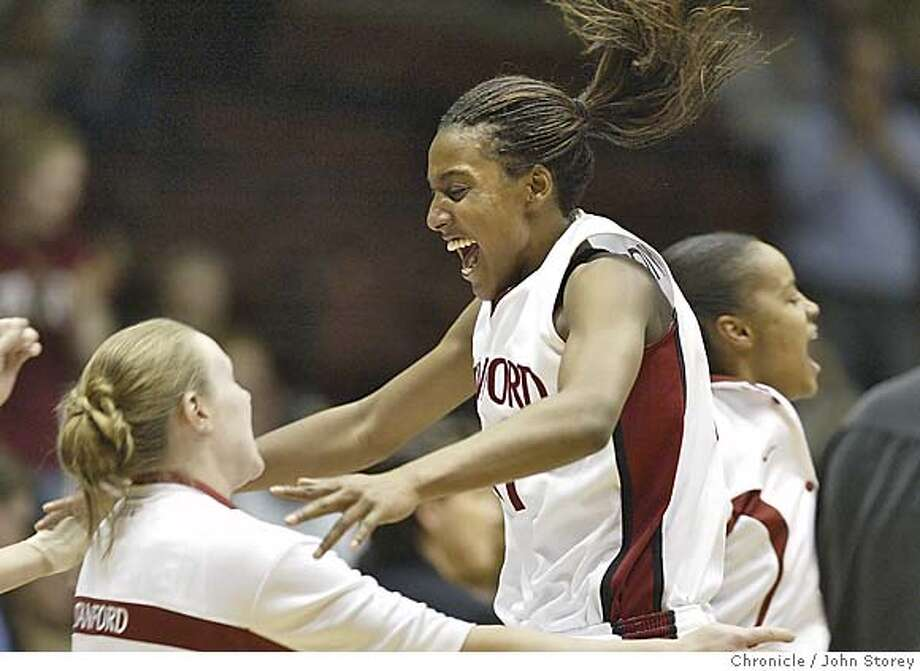 Candice Wiggins jumps into the arms of a teammate after Stanford beat Conneticut. Stanford Cardinal vs. the Connecticut Huskies in the NCAA Women's Basketball Championship in Kansas City. John Storey Kansas City Event on 3/27/05 Photo: John Storey