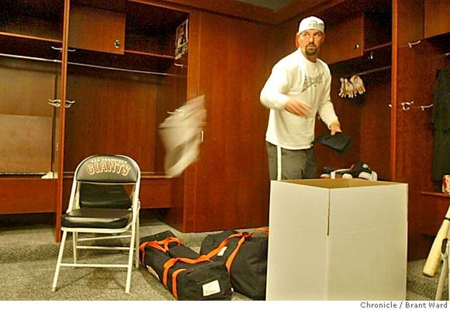 giants013_ward.jpg Giants outfielder Dustan Mohr threw some items from his locker into the trash as he cleaned out his space in the Giants clubhouse Monday.  On the day after their season ended, several Giants players showed up at SBC Park to clean out their lockers and watch the playoffs from home.  10/4/04 Brant Ward Sports#Sports#Chronicle#10/5/2004#ALL#5star##0422394262 Photo: Brant Ward