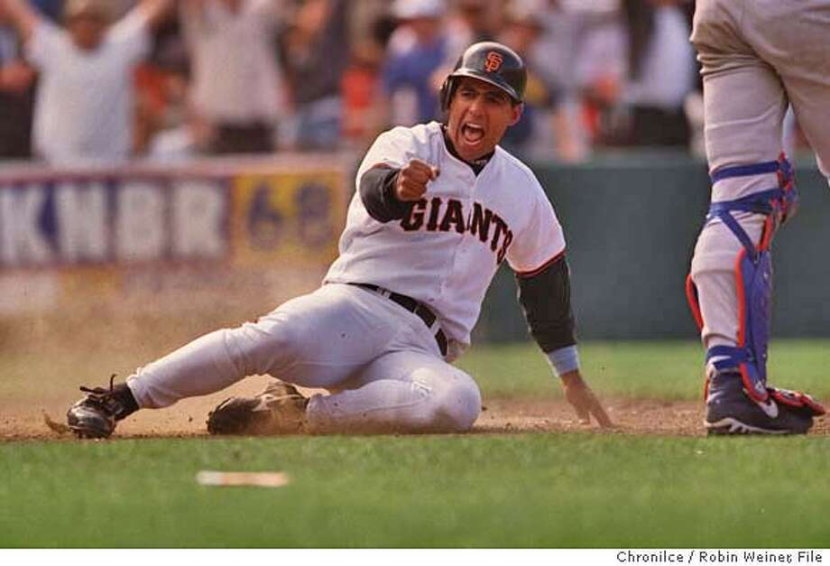 JAVIER/C/20JUN99/SP/RW San Francisco Giants' Stan Javier slides into home scoring the winning run 7-6 against the Chicago Cubs at 3Com Park in San Francisco.  BY ROBIN WEINER/THE CHRONICLE CAT Photo: ROBIN WEINER