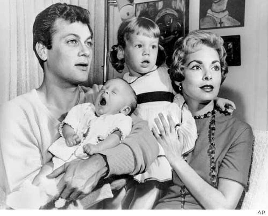 """*** FILE *** Tony Curtis and Janet Leigh are shown with their daughters Kelly, 2 1/2, and newborn Jamie Lee in Hollywood, Ca., Jan. 16, 1959. Janet Leigh, the wholesome beauty who co-starred with James Stewart, John Wayne and Frank Sinatra in films of the 1940s to 1960s and achieved her most lasting fame as the victim of a shower slashing in Alfred Hitchcock's """"Psycho,"""" died Sunday Oct. 3, 2004 at her Beverly Hills, Calif., home, according to a spokeswoman. She was 77. (AP Photo) (AP Photo)"""
