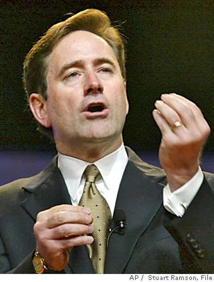 **FILE** Craig A. Conway, president and chief operating officer of PeopleSoft, Inc. addresses attendees of the CeBIT America technology trade show in New York, N.Y., in a Thursday, June 19, 2003 photo. Business software maker PeopleSoft Inc. fired CEO Craig Conway on Friday, Oct. 1, 2004, divorcing itself from the feisty leader who engineered the company's dogged resistance to a $7.7 billion takeover bid by rival Oracle Corp. (AP Photo / Stuart Ramson, File) Ran on: 10-02-2004  Craig Conway Ran on: 10-02-2004  Craig Conway A JUNE 19, 2003 PHOTO. Business#Business#Chronicle#10/5/2004#ALL#5star##0422386995 Photo: STUART RAMSON