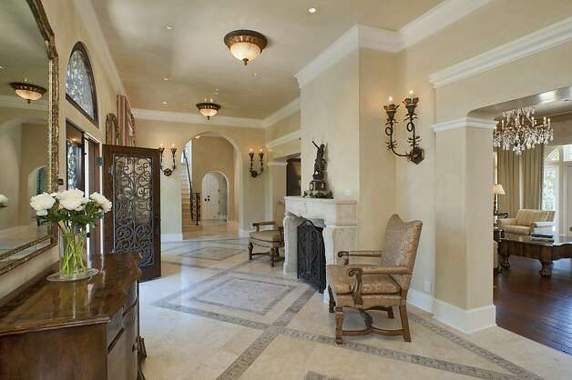 A custom stone fireplace greets visitors in the expansive, rustic foyer. Photo: Pacific Union International, Christie's Great Estates