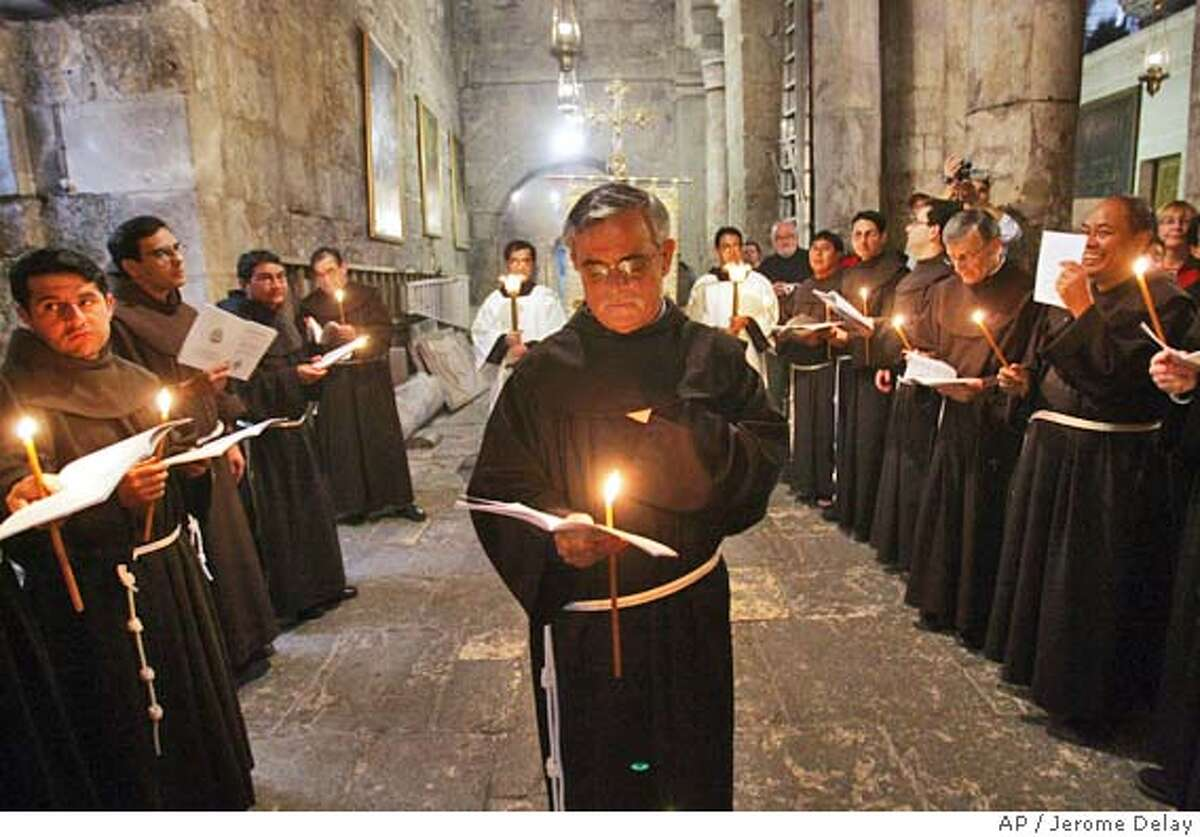Franciscan monks participate in a Holy Saturday procession at the Church of the Holly Sepulchre in Jerusalem, Saturday March 26, 2005. (AP Photo/Jerome Delay)