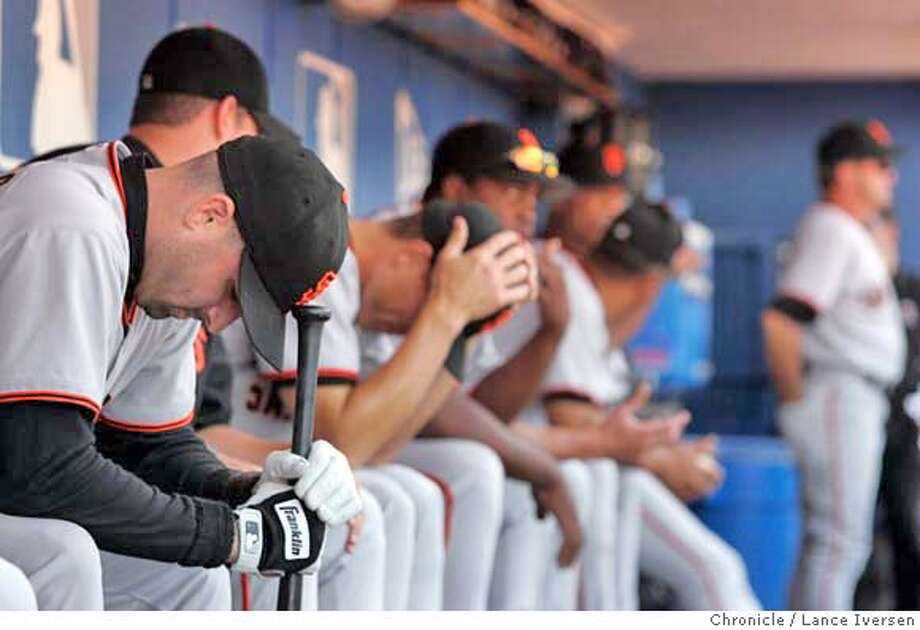GIANTS-200.jpg_  Tony Torcato (left) seams to be in deep thought shortly after the scoreboard lit up with the Astro's score putting them into post-season play. San Francisco Giants vs. Los Angeles Dodgers in the final game of the season for the Giants. By Lance Iversen/San Francisco Chronicle MANDATORY CREDIT PHOTOG AND SAN FRANCISCO CHRONICLE. Sports#Sports#Chronicle#10/4/2004#ALL#5star##0422392575 Photo: Lance Iversen