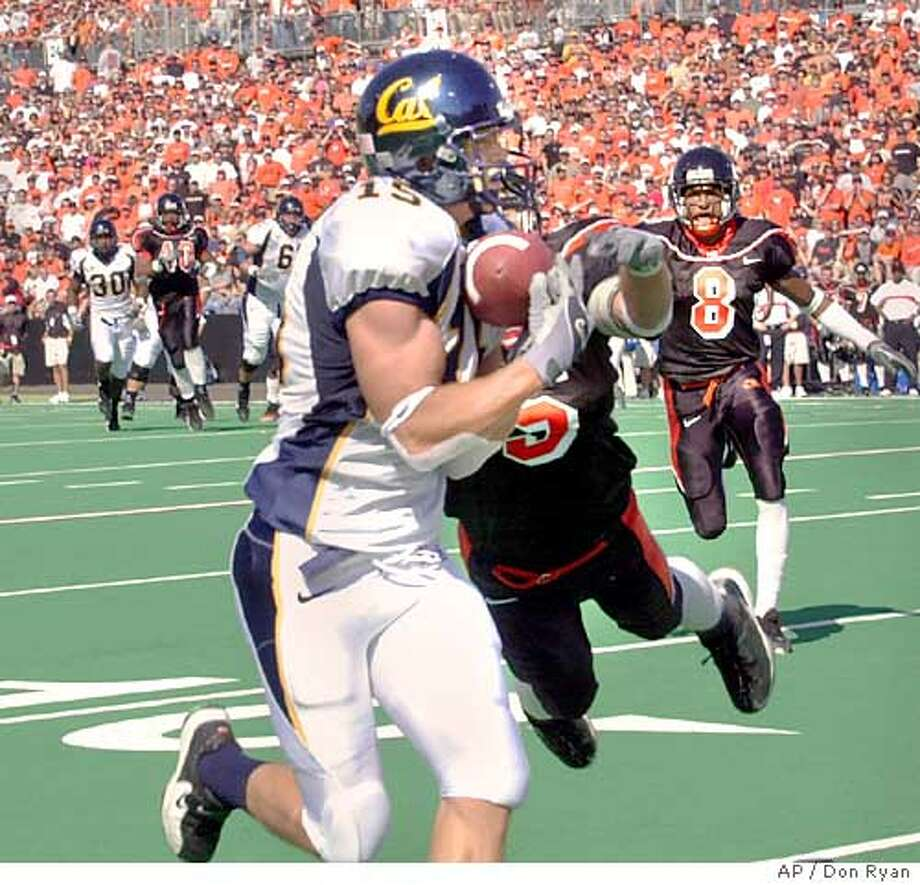 California receiver Chase Lyman hauls in a first -quarter touchdown pass against Oregon State defenders Mitch Meeuwsen (5) and Aric Williams (8) during their Pac-10 game in Corvallis, Ore., Saturday, Oct. 2, 2004.(AP Photo/Don Ryan) Ran on: 10-04-2004  Cal receiver Chase Lyman says it will be business as usual this week as the Bears prepare for top-ranked USC. Ran on: 10-04-2004  Enjoying the Bay Area on a chopper. Ran on: 10-04-2004  Enjoying the Bay Area on a chopper. Photo: DON RYAN