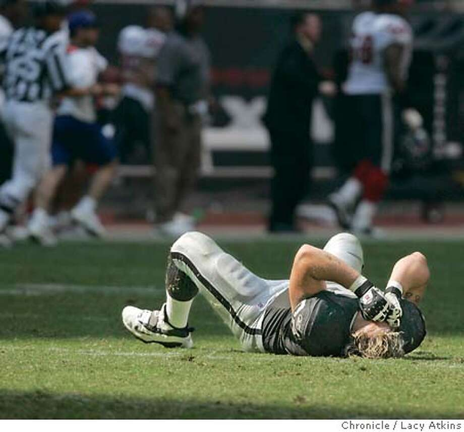 Oakland Raiders Barry Sims drops to the ground and reacts in the fourth quarter to the Houston Texans third interception of the game, Sunday Oct 3, 2004 in Houston. The Raiders lost 30 to 17. OAKLAND RAIDERS vs HOUSTON TEXANS AT THE RELIANT STADIUM, IN HOUSTON TEXAS, OCT. 3, 2004. LACY ATKINS/ The Chronicle Photo: LACY ATKINS