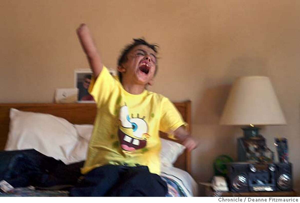 Saleh screams with joy as he scores a point on a video game. He is staying in an apartment provided by Children's Hospital in Oakland. Through an international rescue mission, Saleh Khalaf, 9, on the brink of death after an explosion, was flown from Iraq to Oakland Children's Hospital along with his father, Raheem. This was shot in Oakland. Deanne Fitzmaurice / The Chronicle