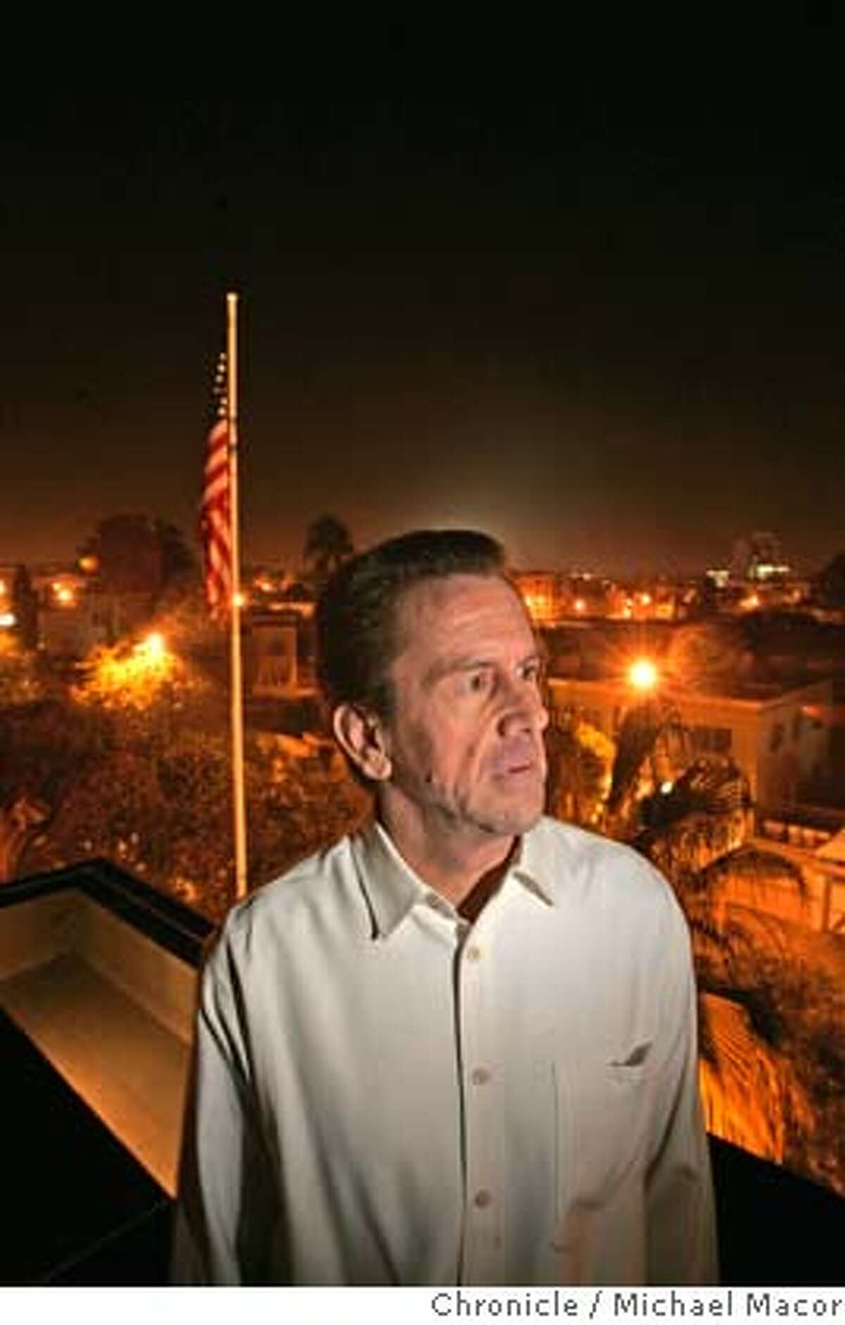 The Ambassador on the roof of his residence, overlooking downtown Rabat. The US Ambassador in Morocco, Thomas Riley, hosts a holiday party for Embassy workers a week before Christmas. Ambassador's residence in Rabat. 12/18/04 Rabat, Morocco Michael Macor / San Francisco Chronicle