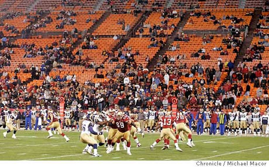 At the 2 minute warning plays continues as the stadium begins to empty. San Francisco Forty Niners vs. St. Louis Rams 10/3/04 Michael Macor / San Francisco Chronicle Photo: Michael Macor