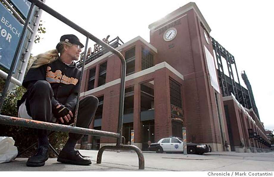 Early in the afternoon at SBC Park, lone fan Ken Tillisch, a native San Franciscan waits to by tickets for a playoff game that will never happen.  Event on 10/3/04 in San Francisco. Photo: Mark Costantini/S.F. Chronicle Metro#Metro#Chronicle#10/04/2004#ALL#5star##0422392501 Photo: Mark Costantini