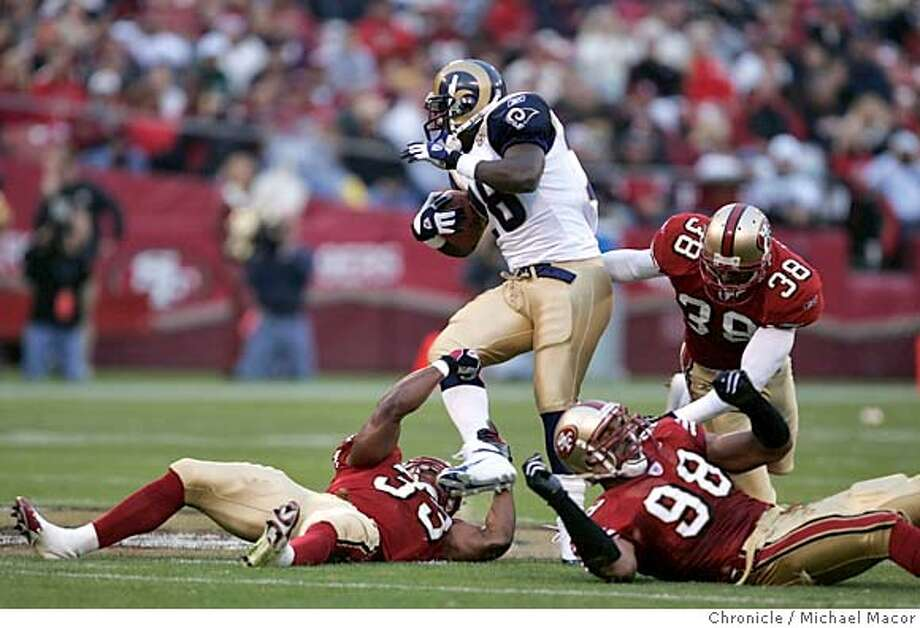 Marshall Faulk ran over the 49ers in the first half San Francisco Forty Niners vs. St. Louis Rams 10/3/04 Michael Macor / San Francisco Chronicle Photo: Michael Macor