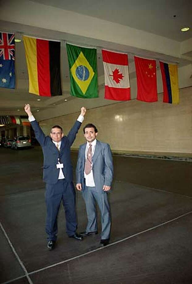 "moviepreview29_yesmen1.JPG ""ANDY"" and ""MIKE"" impersonate members of the World Trade Organization in United Artists documentary THE YES MEN. Credit: Dan Ollman Datebook#Datebook#SundayDateBook#10-03-2004#ALL#Advance##0422251707"