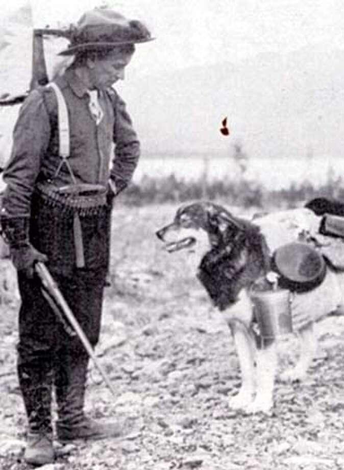 An Alaska prospector with his dog on 9/24/04 in . / HO