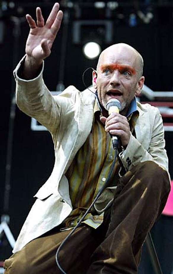 ** FILE ** The singer of the U.S. band R.E.M. Michael Stipe sings during their concert in Hamburg's Volkspark, northern Germany, in this July 1, 2003 file photo. (AP Photo/Christof Stache, File) JULY 1, 2003 FILE PHOTO Photo: CHRISTOF STACHE