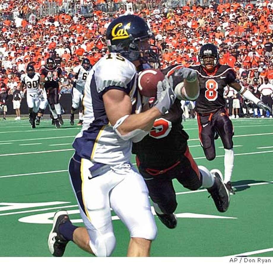 California receiver Chase Lyman hauls in a first -quarter touchdown pass against Oregon State defenders Mitch Meeuwsen (5) and Aric Williams (8) during their Pac-10 game in Corvallis, Ore., Saturday, Oct. 2, 2004.(AP Photo/Don Ryan) Photo: DON RYAN