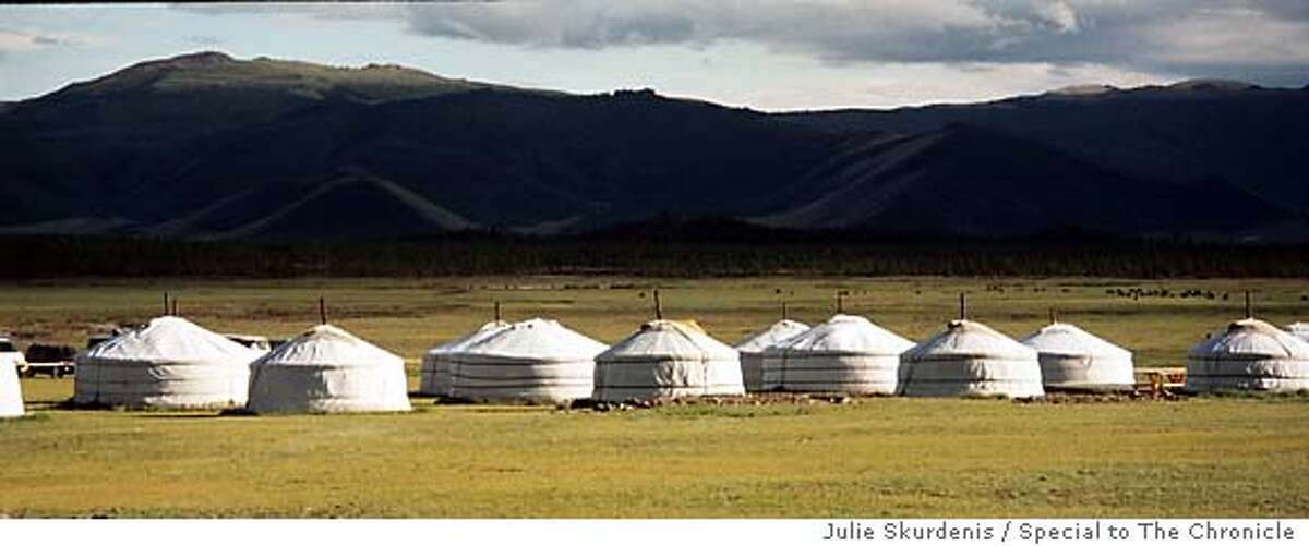 During Naadam, hundreds of gers (better known in the West as yurts) are pitched outside Ulan Bator, drawing visitors and locals alike who stop to sample fermented mare�s milk called airag. Photo by Julie Skurdenis, special to the Chronicle