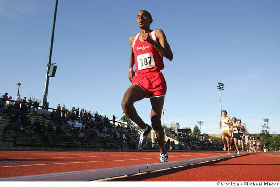 Yosef Ghebray of Logan took his heat in the 3000 meters, setting a meet record with a time of 8:21.74 Stanford Invitational Tack and Field. Bay Area High School Track. 3/25/05 Palo Alto, Ca Michael Macor / San Francisco Chronicle Photo: Michael Macor