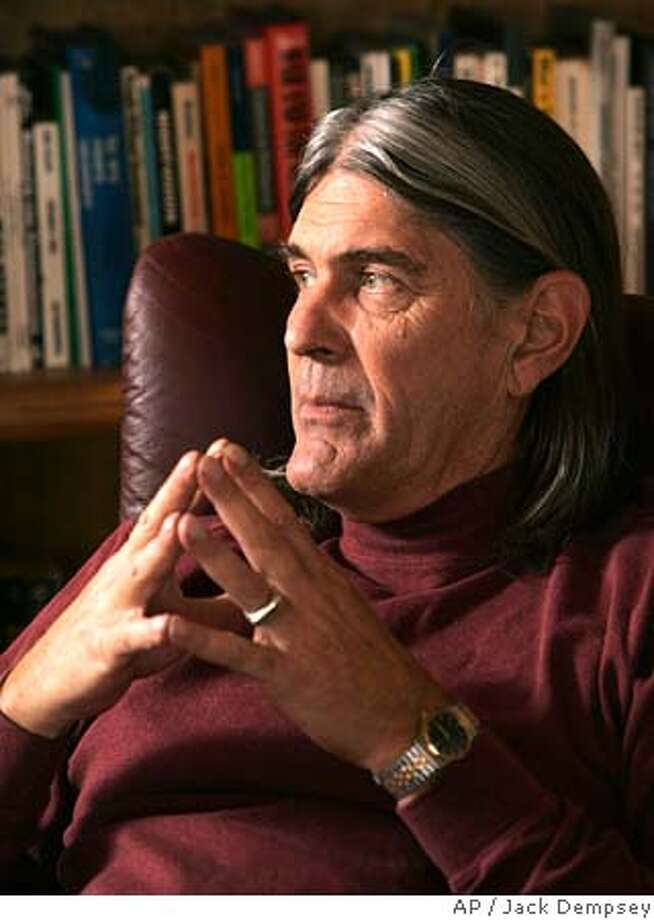 University of Colorado professor of ethnic studies Ward Churchill, is shown duiring an interview with the Associated Press, at his home in Boulder, Colo., Wednesday, March 16, 2005. Churchill, a tenured professor of ethnic studies, set off a firestorm with an essay comparing some Sept. 11 victims to the Nazi bureaucrat who organized the Holocaust. Since the essay resurfaced in January, Gov. Bill Owens has called for his dismissal and the university has begun investigating his scholarship to see whethergrounds exist to dismiss him. (AP Photo/Jack Dempsey) MARCH 16 2005 PHOTO Photo: JACK DEMPSEY