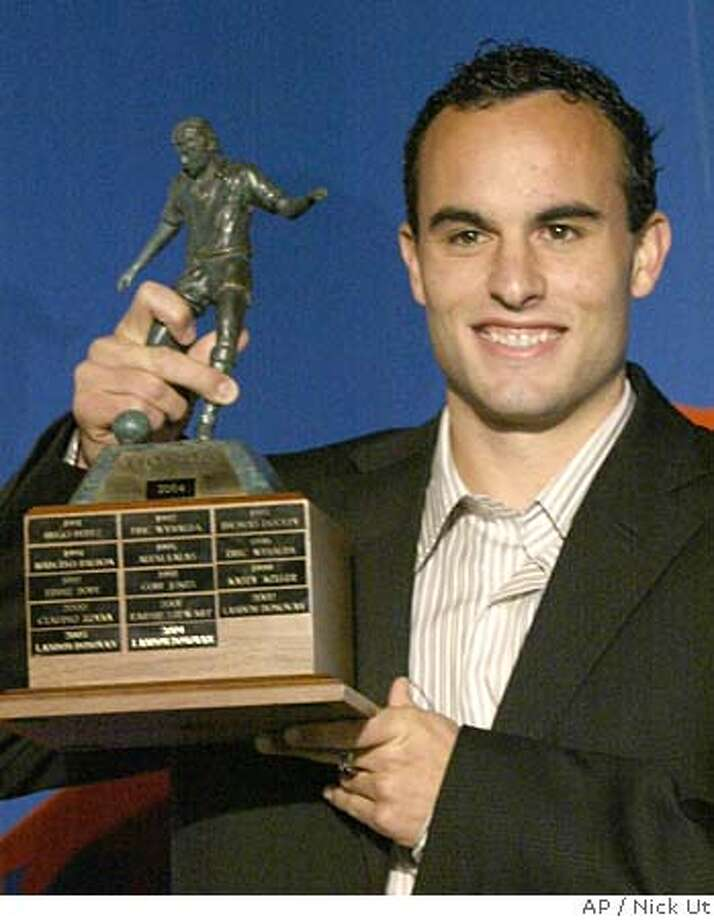 San Jose Earthquakes player Landon Donovan, holds the trophy after being awarded with the Honda Player of the Year Award in Beverly Hills, Calif., Thursday, Nov 18, 2004. Donovan became the first three-time winner of the award given annually to the outstanding member of the U.S. national team. (AP Photo/Nick Ut) Ran on: 11-19-2004 Ran on: 11-19-2004 Ran on: 02-19-2005  Landon Donovan Photo: NICK UT