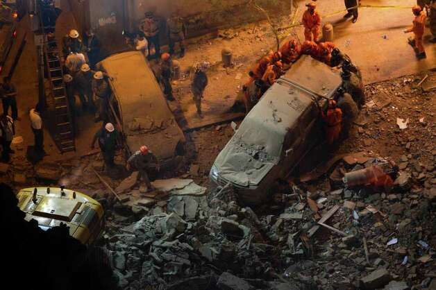 Rescue worker remove a car after buildings collapsed in Rio de Janeiro, Brazil, Wednesday. Photo: AP