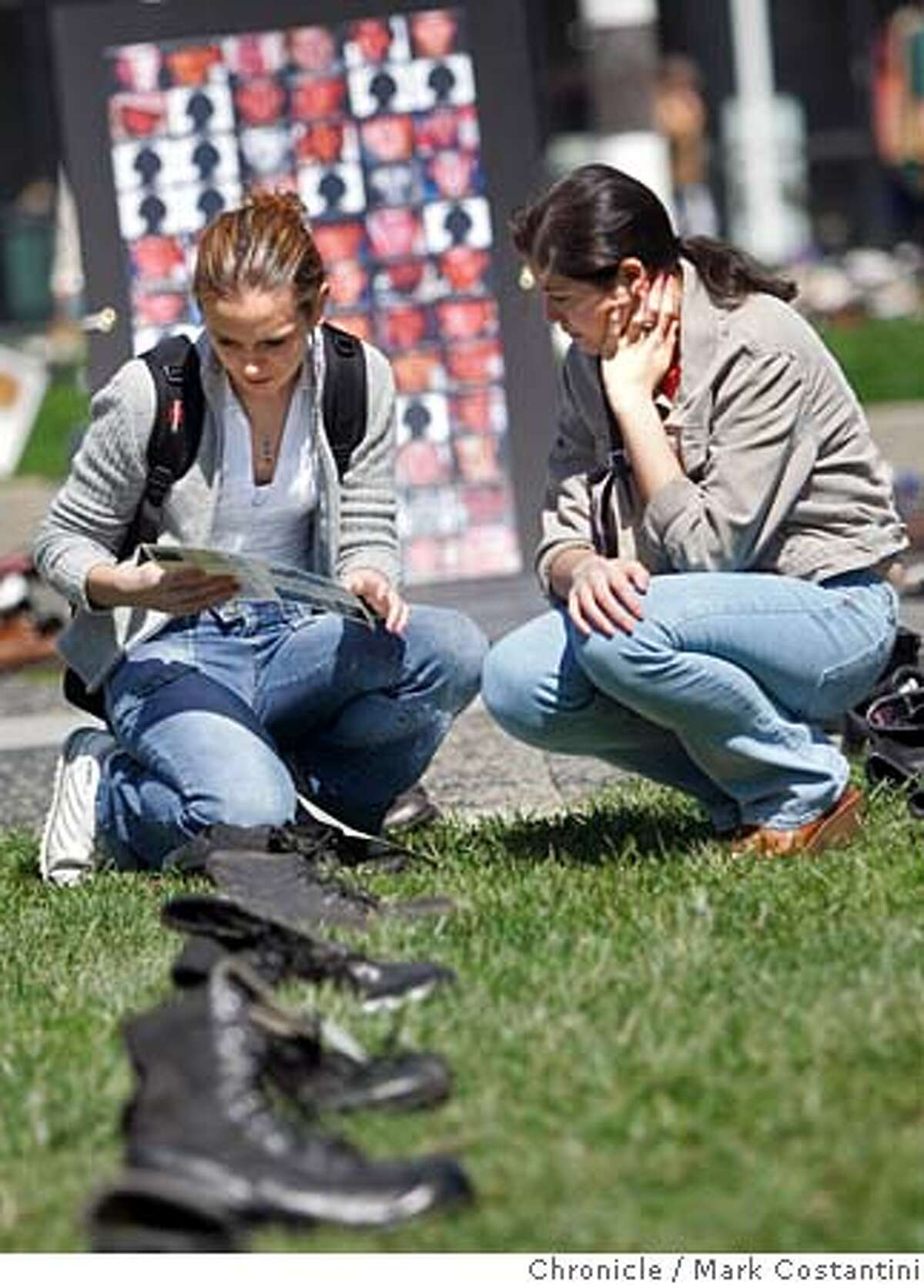 Mercy High School students(l-r) Monica Malton, 17 and Claudia Rivera, 18 view th e memorial. They are both from S.F. The Eyes Wide Open war casualties memorial featuring over 1,500 pairs of empty combat boots � tagged with the names of U.S. soldiers who died in the Iraq war � together with a field of shoes and wall of names to memorialize the Iraqis killed will be coming to San Francisco�s Civic Center on March 25th and 26th and in Union Square on the 27th. Mark Costantini /San Francisco Chronicle