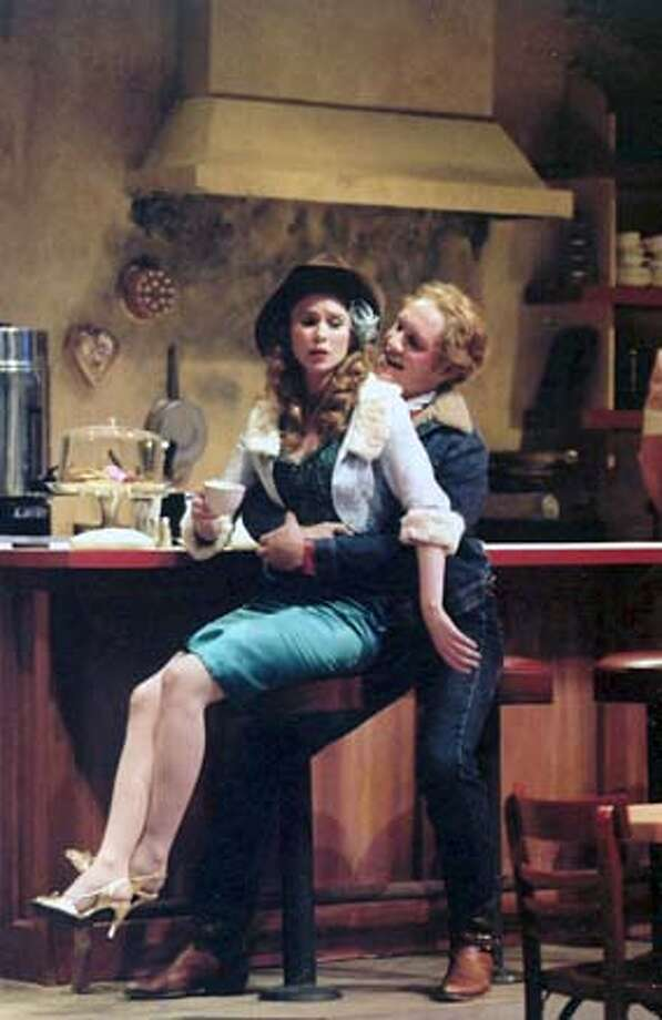 BUS24 Cherie (played by Kathleen Dobbs) and Bo (Craig Marker) in Bus Stop. CR: Ed Smith