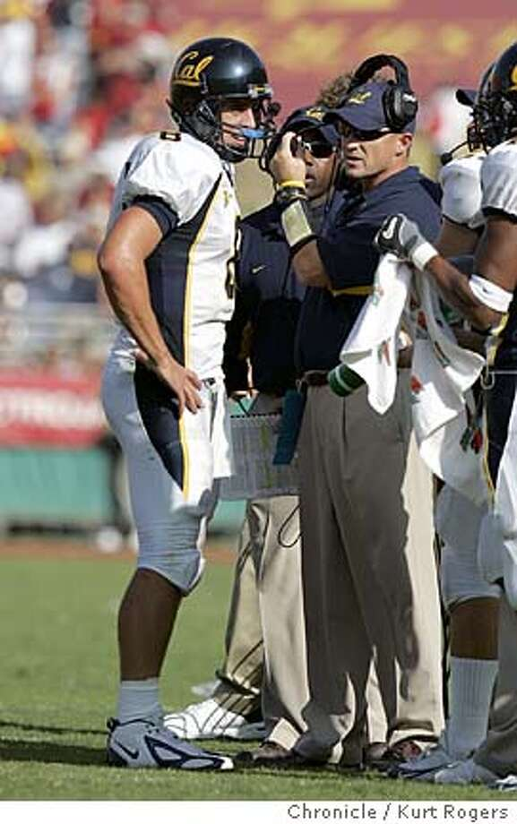 With 1:21 left in the game Cal called a time out and Aaron Rodgers talks it over with coachPete Carroll .  The University of California Berkeley Golden Bears vs the University of Southern California Trojans at the Los Angeles Memorial Coliseum.  CAL_641_kr.JPG 10/9/04 in Los Angeles,CA.  KURT ROGERS/THE CHRONICLE Ran on: 10-11-2004  Cal coach Jeff Tedford and QB Aaron Rodgers, left, had better offensive numbers than USC's Pete Carroll and Matt Leinart. MANDATORY CREDIT FOR PHOTOG AND SF CHRONICLE/ -MAGS OUT Photo: KURT ROGERS