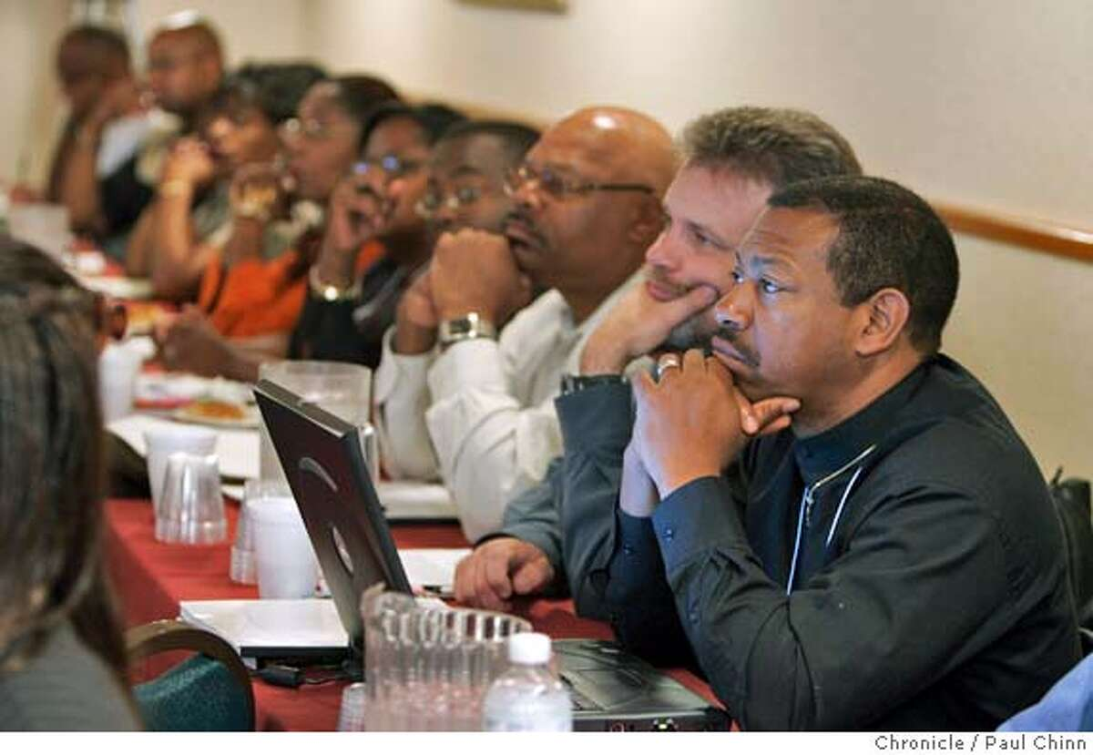 Conference attendees listen to Pastor Dion Evans' opening remarks. The faith-based Certified Marriage Education Training Seminar attracted participants from around the country on 9/23/04 in Oakland, CA. PAUL CHINN/The Chronicle
