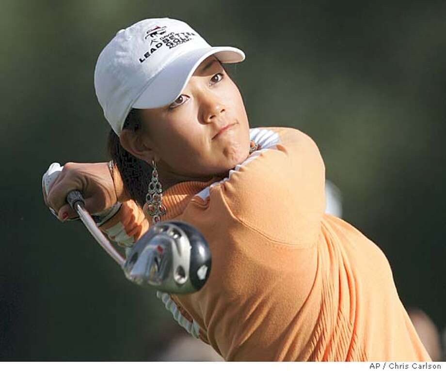 Golfer Michelle Wie, 15, watches her tee shot on the second hole during the first round of the Kraft Nabisco Championship golf tournament at the Mission Hills Country Club in Rancho Mirage, Calif. on Thursday, March 24, 2005. (AP Photo/Chris Carlson) Photo: CHRIS CARLSON