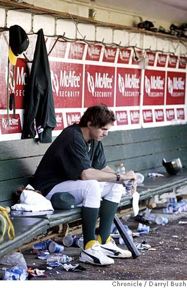 Athletics Barry Zito sits dejected in the A's dugout after the Athletics were eliminated from the postseason in a defeat to the Anaheim Angels. Oakland Athletics vs. Anaheim Angels at Oakland. 10/2/04 in Oakland  Darryl Bush / The Chronicle Photo: Darryl Bush