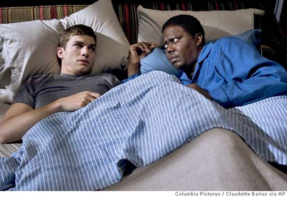 "In this photo provided by Columbia Pictures, Simon Green (Ashton Kutcher, left) tries to win approval from his soon to be father in la, Percy Jones (Bernie Mac) in "" Guess Who."" (AP Photo/Columbia Pictures/Claudette Barius) Photo: CLAUDETTE BARIUS"