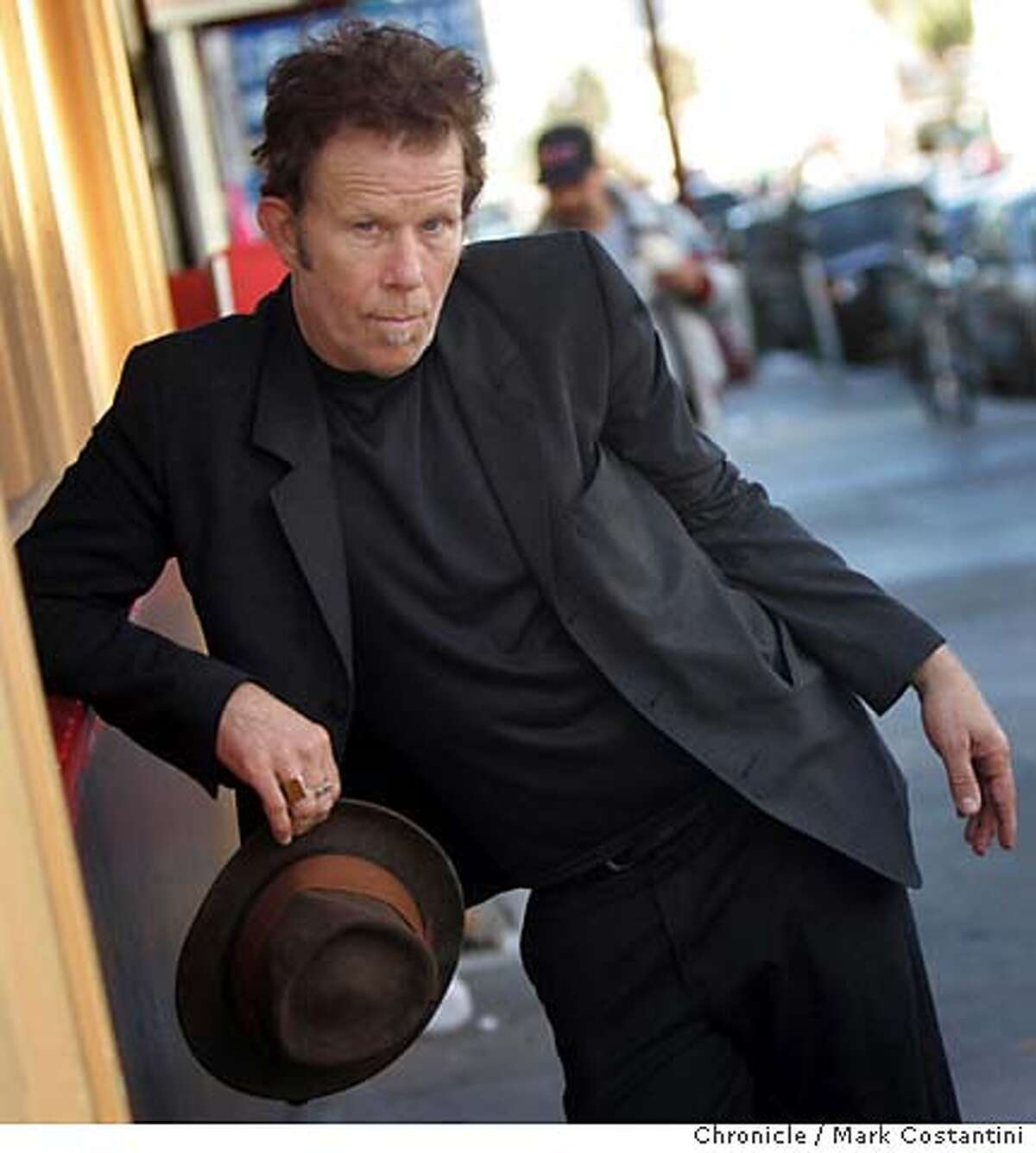 PORTRAIT OF SINGER TOM WAITS INSIDE THE NEW MISSION THEATER, AN OLD, CLOSED VAUDEVILLE THEATER ON MISSION ST. EVENT ON 9/20/04 IN San Francisco. S.F. Chronicle Photo: Mark Costantini Datebook#Datebook#SundayDateBook#10/03/2004#ALL#Advance##0422368361