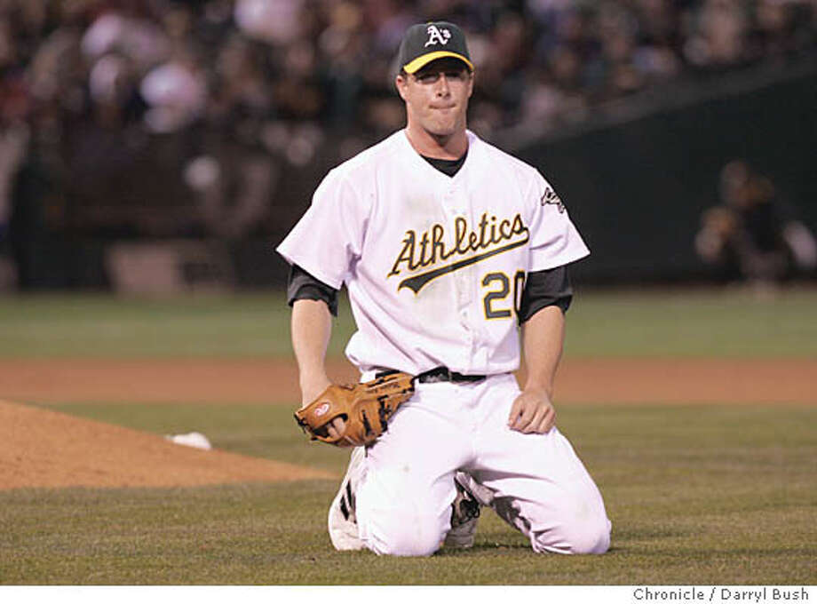 Oakland Athletics pitcher Mark Mulder is stunned after trying to field a bunt that allowed a run to score in the second inning vs. Anaheim Angels at Oakland. 10/1/04 in Oakland  Darryl Bush / The Chronicle Photo: Darryl Bush