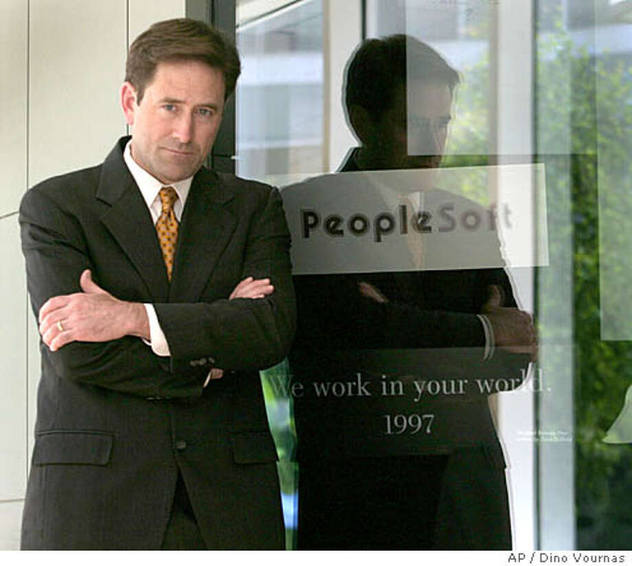 ** FILE ** Craig Conway, the president and CEO of business software maker PeopleSoft, the target of a hostile takeover by Larry Ellison of Oracle, is shown in a photo at his company's headquarters, Wednesday, June 12, 2003, in Pleasanton, Calif. Invigorated by a pivotal antitrust victory, Oracle Corp. will attack increasingly vulnerable takeover target PeopleSoft Inc. again in a court battle, set to begin Monday, Oct. 4, 2004, over two of the countermeasures used to thwart the business software maker's $7.7 billion acquisition bid. (AP Photo/Dino Vournas) Photo: DINO VOURNAS
