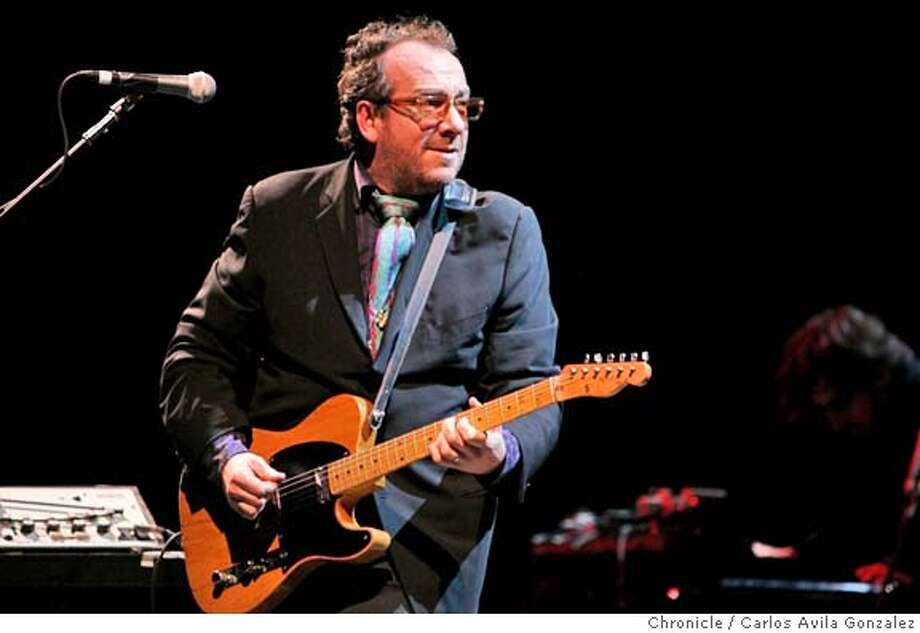 Costello24_007_CAG.JPG  Elvis Costello in concert at the Paramount Theater in Oakland, Ca., on Tuesday, March 22, 2005. Photo by Carlos Avila Gonzalez / The San Francisco Chronicle  Photo taken on 3/22/05 in Oakland, CA. MANDATORY CREDIT FOR PHOTOG AND SAN FRANCISCO CHRONICLE/ -MAGS OUT Photo: Carlos Avila Gonzalez
